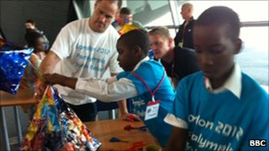 Children from Hackney Schools and Paralympic gold medal swimmer David Roberts make lanterns for a procession ahead of the relay announcement