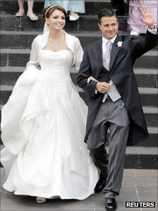 Enrique Pena Nieto walks with his wife, actress Angelica Rivera, after getting married at the Metropolitan Cathedral in Toluca near Mexico City 27 November  2010