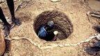Malian miner Pascal Dambele digging a shaft