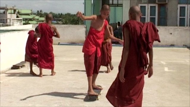 Children learning to skateboard in Burma