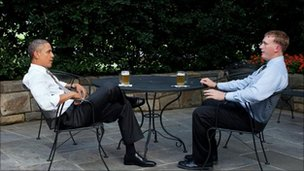 US President Barack Obama has a beer with Dakota Meyer