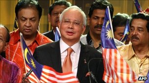 Malaysian Prime Minister Najib Razak (c) during a televised statement on security laws
