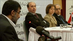 Syria's new national council is announced in Istanbul. From left: Imad Eldin Rashid, Ahmed Ramadan, Basma Kadmadi and Abdulbaset Sida.