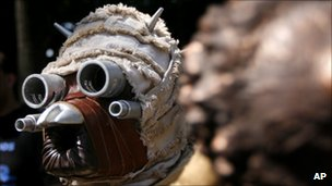 A Star Wars film fan dressed as a Tusken Raider