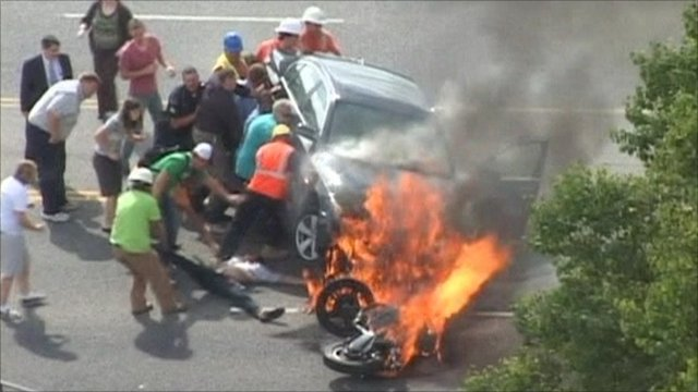 Flaming wreckage at accident scene