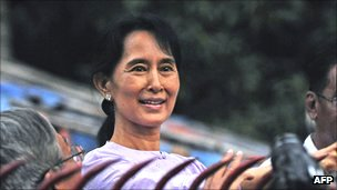 Aung San Suu Kyi greeting supporters outside her house after her release from house arrest in 2010