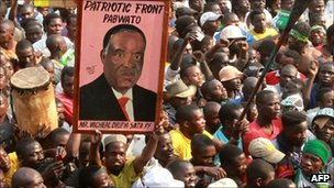 A Patriot Front supporter holds a portrait of the PF leader Michael Sata during a rally in the Zambian district of Mandevu in Lusaka on 15 September 2011