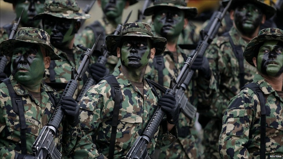 Mexican soldiers take part in a parade in Mexico City
