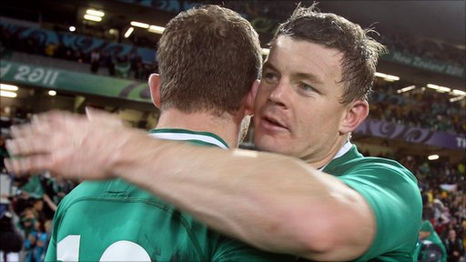 Brian O'Driscoll embraces his centre partner Gordon D'Arcy