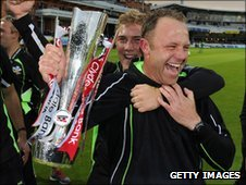 Surrey cricket manager Chris Adams is embraced by captain Rory Hamilton-Brown