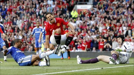 Chelsea's Ashley Cole tackles Manchester United's Javier Hernandez