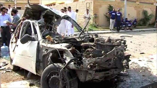 Car destroyed by blast in Karachi