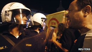 An anti-austerity protester shouts at police officers outside the Greek parliament 18/9/2011
