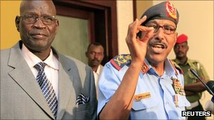 Sudanese Defence Minister Abdelrahim Mohamed Hussein (R) speaks during joint news conference with his southern counterpart John Kong Nyuon after signing an agreement in Khartoum 