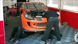 Mechanics work on a Ginetta car