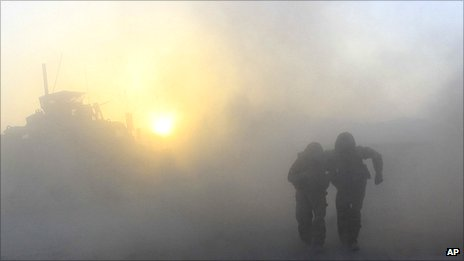 Soldiers walking after a roadside bomb exploded in the Helmand Province of southern Afghanistan