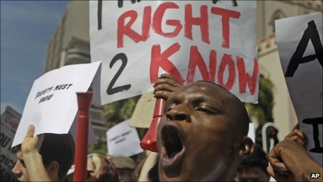 A man shouts out during a protest against the Protection of Information Bill in the city of Cape Town, South Africa, Saturday 17 September 2011 during a march to parliament