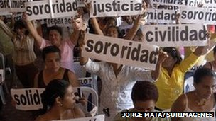 Women in Colombia hold up banners as part of a demonstration to call for justice for victims of sexual abuse in Barrancabermeja, 2007