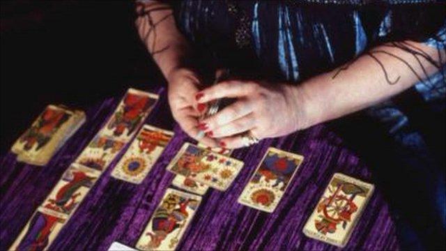 woman dealing tarot cards