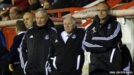 Aberdeen boss Craig Brown (middle) has vowed to continue at Pittodrie