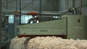 Bales of cotton being processed