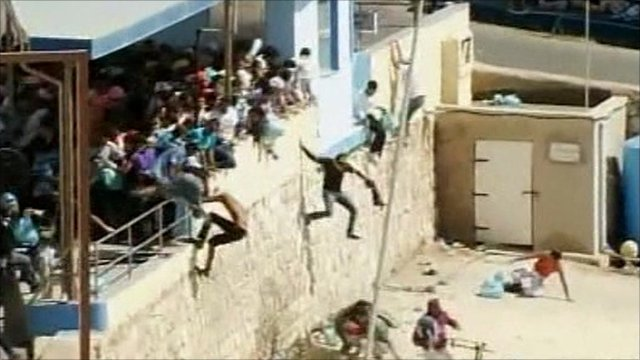 Migrants on Italian island of Lampedusa fleeing police