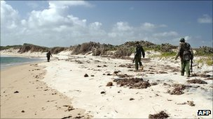 Kenyan police patrol a beach near the Kiwayu resort