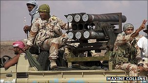 Anti-Gaddafi forces sitting in a truck