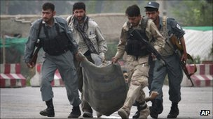 Afghan security forces carry the body of a colleague, who was killed during a gun battle with Taliban militants in Kabul, Afghanistan, 14 Sept 2011