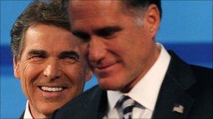 Texas Gov Rick Perry (left) and former Massachusetts Governor Mitt Romney