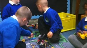 Four pupils taking part in an activity at Baguley Hall Primary School
