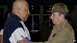 Cuban President Raul Castro embraces Hugo Chavez of Venezuela
