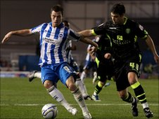 Ashley Barnes of Brighton (L) evades Darren O'Dea of Leeds (R)
