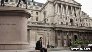 City worker sits alone outside Bank of England