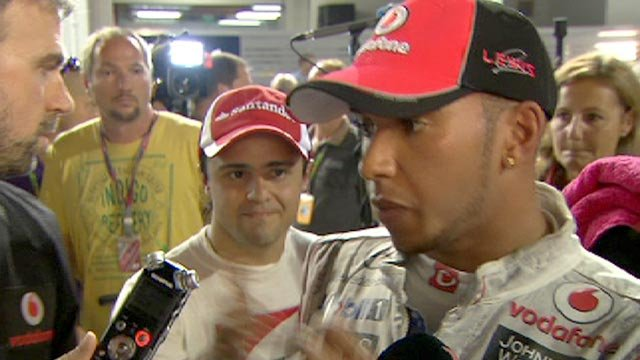 Lewis Hamilton is confronted by Felipe Massa