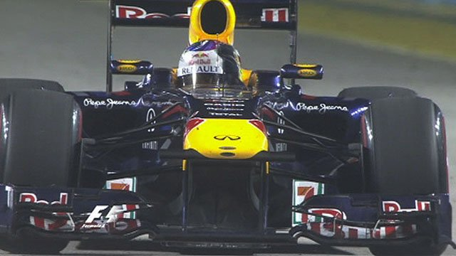 Sebastian Vettel salutes the crowd after his victory in Singapore