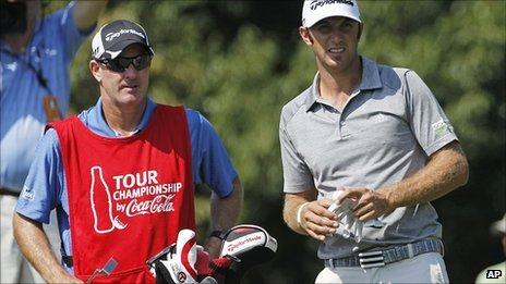 Joe LaCava (left) talks to Dustin Johnson during the final round of the Tour Championship golf tournament