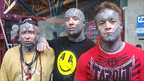 Three tattooed men