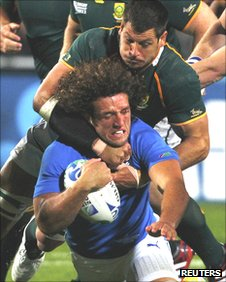 Namibia captain Jacques Burger is tackled by South Africa number eight Pierre Spies