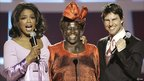 Wangari Maathai with US talk show host Oprah Winfrey (left) and US actor Tom Cruise (right) after winning the Nobel prize in December 2004