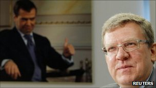 Russian Finance Minister Alexei Kudrin with photo of President Dmitry Medvedev in background - 13 September 2011