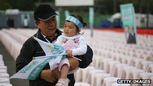 Taiwanese man holding child