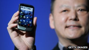 HTC CEO Peter Chau holding phone