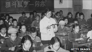A 1960s photo released by the Chinese official news agency of high school students, reading Mao's Little Red Book