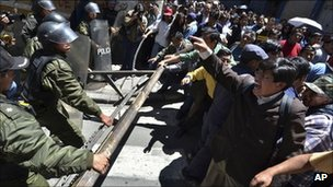 Protesters clash with police officers in La Paz, Bolivia on Monday