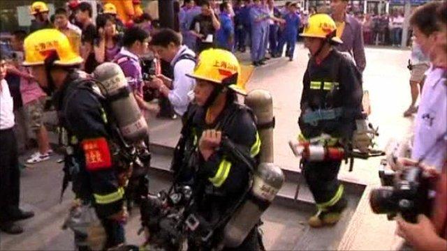 Fire crews in Shanghai walk with breath apparatus
