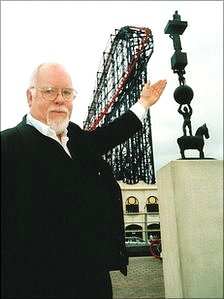 Sir Peter Blake with his artwork in Blackpool