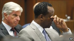 Conrad Murray wipes a tear from his eye during the opening statements of his trial