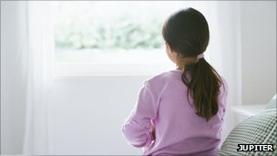 Girl staring out of a window