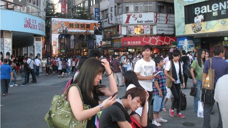 Crowd in Taiwanese city street
